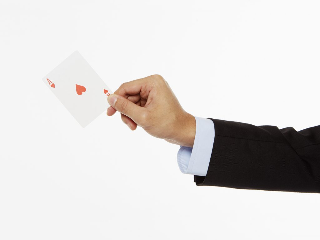 Businessman holding an ace card